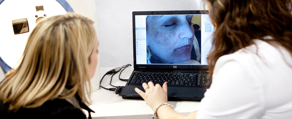 Women looking at skin analysis on a monitor